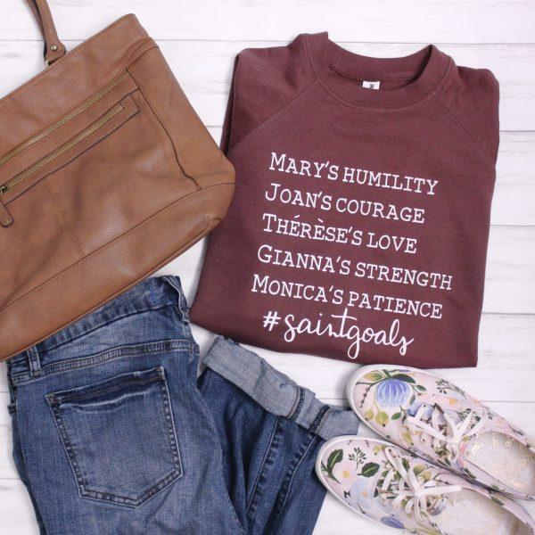 Catholic woman's saint goals sweatshirt